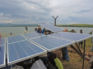 The course participants installing the solar panels in Kashaka, Uganda. The panels are important for the sustainability of the water project as it will reduce the running costs.