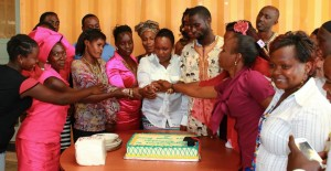 In a ceremonial act the students cut a cake before sharing it with their friends and family members.