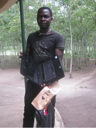 Vincent in Katunguru-Rubirizi, western Uganda with his new laptop.