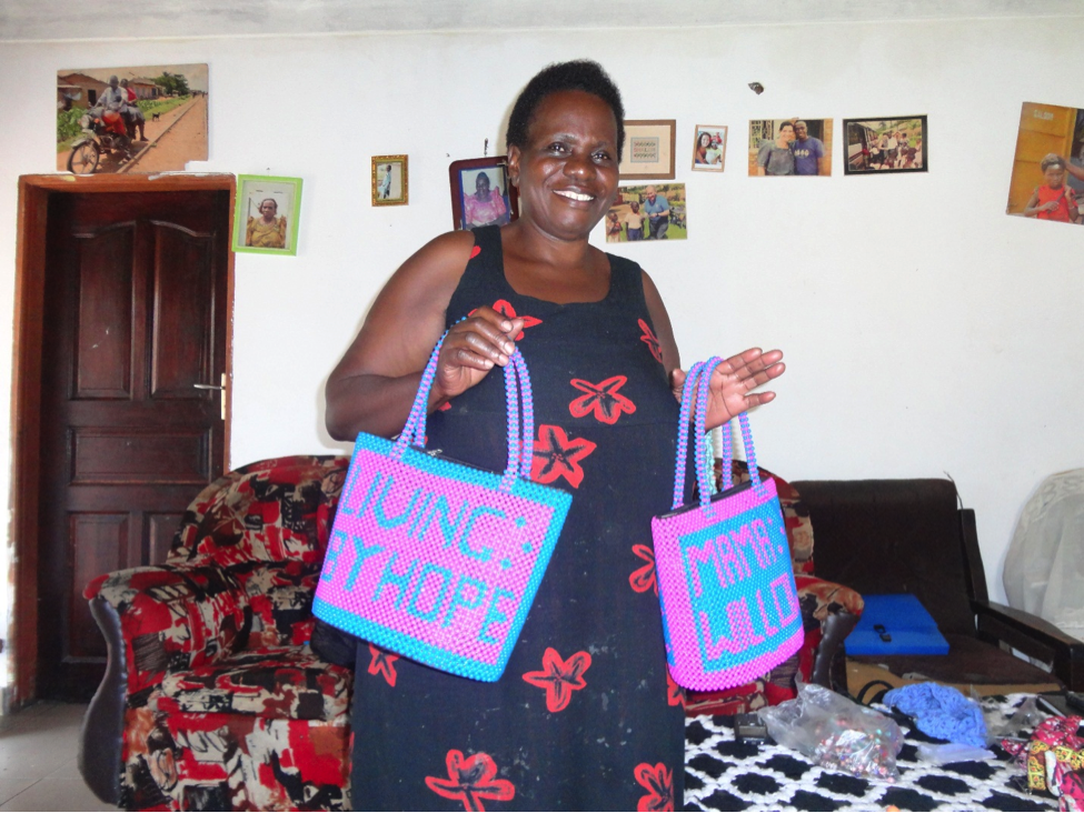 Former SMP participant Jenifer proudly presenting one among MAKULA group's creative and colourful products.